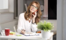 businesswoman-working-home-484619601-small